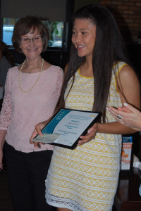 Amber with award and check in hand with Donna Lancaster, Club Vice President
